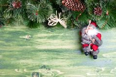 Green board with pine needles and cones Christmas toys and Chris Royalty Free Stock Image