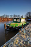 Green Boat. A green boat with frost royalty free stock photos