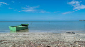 Green boat in the beach. Photo taken in Dominican Republic Stock Photography