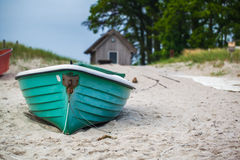 Green boat at beach Stock Image