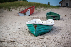 Green boat at beach Stock Photos