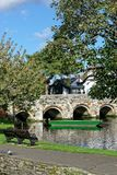 Green Boat by Bridge Christchurch. A green boat by a bridge in Christchurch along the River Avon Royalty Free Stock Image