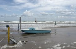 Green boat at ebb tide. Green boat on the beach at ebb tide in Southern Italy Royalty Free Stock Image