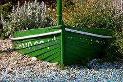 Green boat with flowers royalty free stock photos