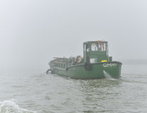 Green Boat and Foggy Day Royalty Free Stock Image