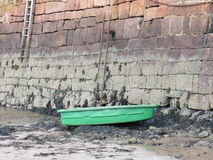 Green boat by Harbour wall Stock Photography
