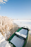Green boat on ice in winter landscape Royalty Free Stock Images