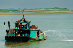 Green boat on Irrawaddy river Stock Image