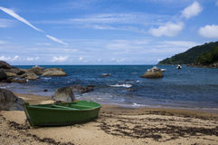 Green Boat in a Peaceful Little Brazilian Beach. Little boat stands in the sand of a remote beach in Ihabela, Brazil Stock Photography