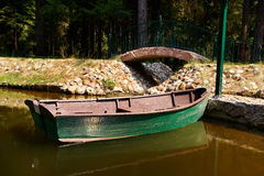 Green boat at a pier Royalty Free Stock Images