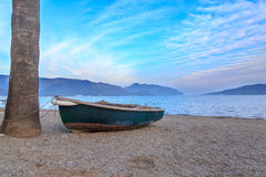 Green boat on sands of Marmaris beach in Marmaris Royalty Free Stock Image