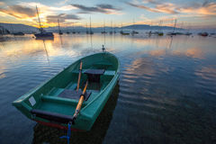 Green Boat and Sunrise Royalty Free Stock Image