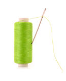 Green Bobbin with needle isolated Royalty Free Stock Images