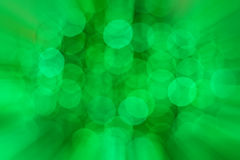 Green bokeh of Christmas light with zoomed in effect Royalty Free Stock Photography