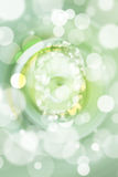 Green bokeh number background, blured Stock Images