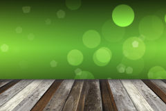 Green bokeh and sunlight and wood floor. Beauty natural backgroud Stock Photography