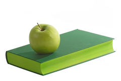 Green Book. With green apple - isolated on white Royalty Free Stock Photography