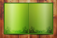 Green book. On the wood background Stock Photos