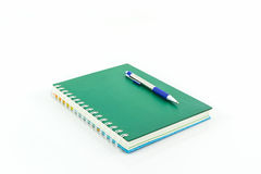 Green book with pen. Royalty Free Stock Photo