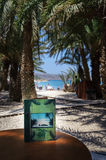 Green book on wooden table at Vai Palm beach on Crete island Royalty Free Stock Image