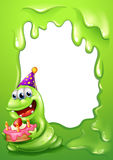 A green border design with a monster holding a cake Stock Photos