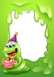 A green border design with a monster holding a cake Stock Photos
