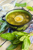 Green borsch with sorrel and egg. In the tureen royalty free stock image