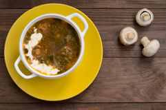 Green borscht with mushrooms. Wooden background. Top view Royalty Free Stock Photography