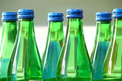 Green bottle. Standing on the table Stock Photos