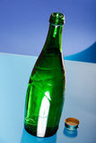 Green bottle. On the table Stock Photos