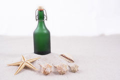 Green bottle on beach Royalty Free Stock Photography