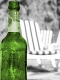 Green bottle of beer. On the beach Royalty Free Stock Photo
