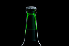 Green bottle beer close-up over black Stock Photography