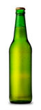 Green bottle of beer and drops Stock Images
