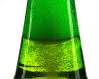 Green bottle of beer and gas bubbles Stock Image