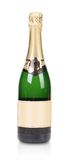 Green bottle of champagne with golden top. Stock Image