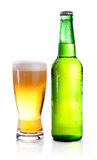 Green Bottle with Condensation and Glass of beer Stock Photo