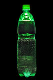 Green bottle with cream-soda Royalty Free Stock Images