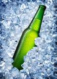 Green bottle in ice Stock Photo