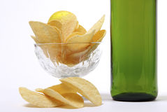 Green bottle of light beer and potato chips Royalty Free Stock Photos