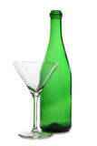 Green bottle and one glasses Stock Images