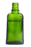 Green bottle with an organic oil Stock Photo