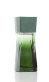 Green bottle of perfume. On a white background Royalty Free Stock Photo