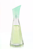 Green bottle of perfume on a white background. Green bottle of perfume on a white Royalty Free Stock Images