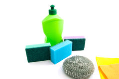Green bottle, rags and sponges Stock Photo
