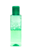 Green bottle with shampoo Stock Image