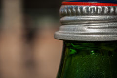 Green bottle and silver cap Stock Image