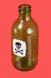 Green bottle with skull and crossbones Royalty Free Stock Photography