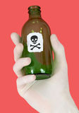 Green bottle with skull and crossbones Stock Photography