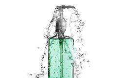 Green Bottle Splash Royalty Free Stock Photography